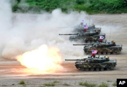 FILE - In this photo provided by the South Korean Defense Ministry, a South Korean marine K1 tank fires during a joint military exercise between South Korea and the United States in Pohang, South Korea, July 6, 2016.