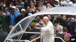 In this July 27, 2013 file photo, Pope Francis waves to people from his popemobile in Rio de Janeiro, Brazil. Latin Americans who were born into Roman Catholic families have increasingly left the faith for Protestant churches, while many others have dropped organized religion altogether in a major shift in the region's religious identity, according to a survey released Thursday Nov. 13, 2014. (AP Photo/Andre Penner, File)