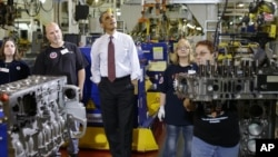 President Barack Obama watches workers during a visit to the heavy duty engines line at the Daimler Detroit Diesel plant in Redford, Michigan, Monday, Dec. 10, 2012.