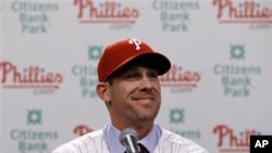 Philadelphia Phillies pitcher Cliff Lee smiles during a baseball news conference, Wednesday, Dec. 15, 2010, in Philadelphia.