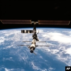NASA's twin brother astronauts are scheduled to meet up at the International Space Station.