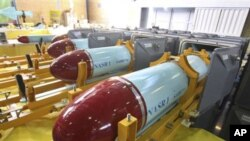 In this photo released by the Iranian Defense Ministry, which says Nasr 1 (Victory) missiles are seen in a factory in Tehran, 07 Mar 2010