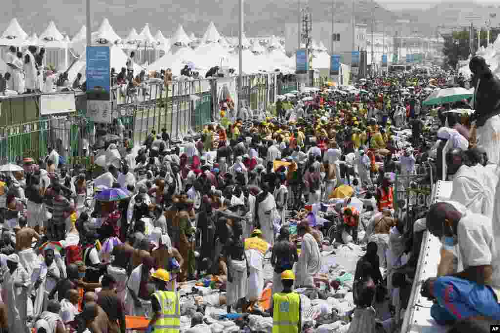 Muslim pilgrims and rescuers gather around the victims of a stampede in Mina, Saudi Arabia during the annual hajj pilgrimage. More than 700 pilgrims were killed and hundreds were injured​, Saudi authorities said.