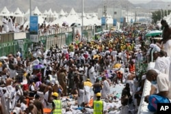 Muslim pilgrims and rescuers gather around the victims of a stampede in Mina, Saudi Arabia, during the annual hajj pilgrimage, Sept. 24, 2015.