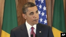 US President Barack Obama makes a statement on the ongoing showdown in Libya, during his news conference at the Palacio do Planalto in Brasilia, Brazil, March 19, 2011