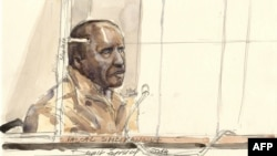 This court sketch in Paris shows Pascal Simbikangwa, a former Rwandan army captain charged with complicity in the genocide that left 800,000 dead, on the first day of his trial, the first of its kind, in France, Feb. 4, 2014.