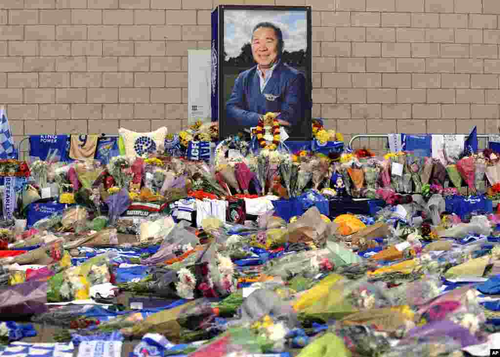 Tributes from supporters are seen outside Leicester City Football Club after a helicopter crashed Saturday killing Leicester City's owner, Thai billionaire Vichai Srivaddhanaprabha, and four other people, in Leicester, England,