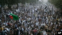 Supporters of the Pakistan Defense Council, a coalition of Islamic parties, take part in a rally to condemn U.S. drone attacks in Pakistani tribal areas, Sunday, Dec. 1, 2013 in Lahore, Pakistan.