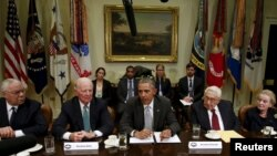 FILE - Former U.S. secretaries of state meet with President Barack Obama to discuss the Trans-Pacific Partnership at the White House in Washington, Nov. 13, 2015.