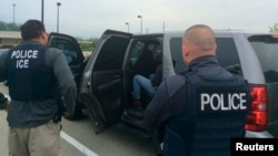 FILE - Officers from U.S. Immigration and Customs Enforcement's (ICE) are shown during an operation targeting criminal aliens and other immigration violators in Philadelphia, May 11, 2016.