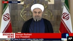 This image made from video broadcast on Press TV, Iran's English language state-run channel shows President Hassan Rouhani making a statement in Tehran following announcement of the Iran nuclear deal, July 14, 2015.