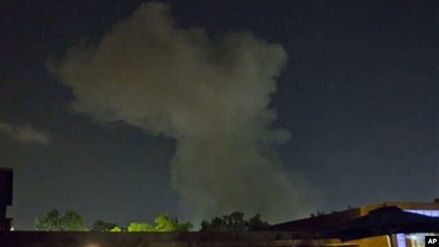 A plume of smoke rises following an late-night airstrike in Tripoli, Libya, May 24, 2011