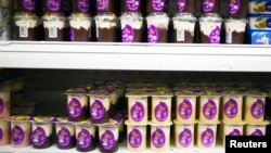 """Milky"" pudding are seen on shelves in a supermarket in the town of Sderot near the Israeli-Gaza border in southern Israel, December 18, 2014."