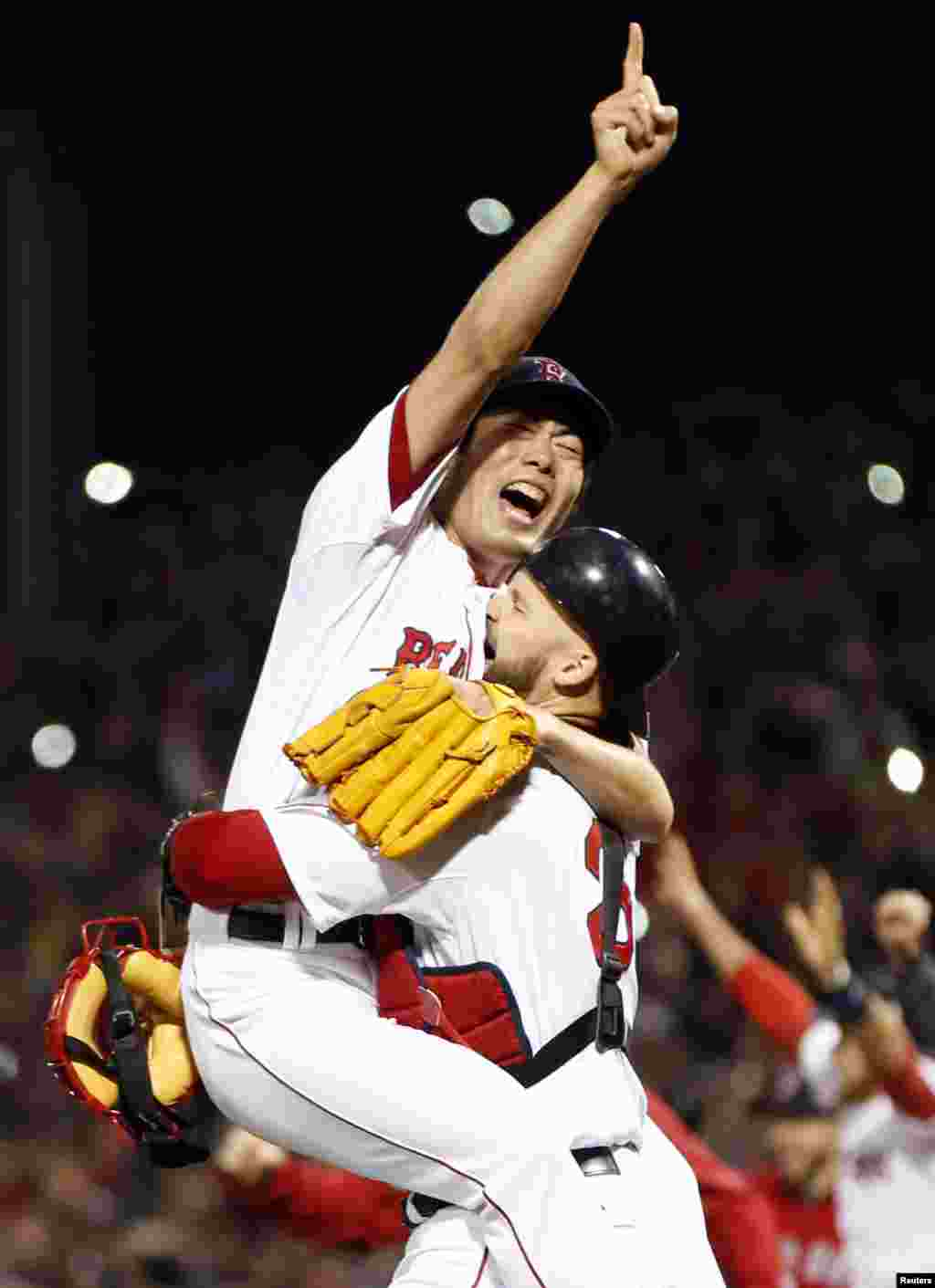 Oct 30, 2013; Boston, MA, USA; Boston Red Sox relief pitcher Koji Uehara (19) reacts with catcher David Ross (3) after defeating the St. Louis Cardinals in game six of the MLB baseball World Series at Fenway Park. Red Sox won 6-1. Mandatory Credit: Greg M