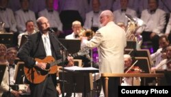 John Williams leading the Boston Pops with James Taylor on July 14, 2012. (Hilary Scott)