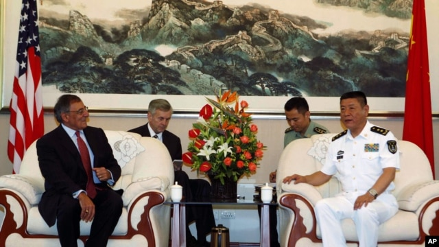 U.S. Defense Secretary Leon Panetta (L) meets with the Commander of the North Sea Fleet Vice Adm. Tian Zhong (R) in Qingdao, China before touring Chinese naval vessels, September 20, 2012.