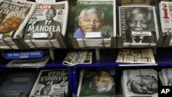 Newspapers with pictures of Nelson Mandela on the front page on sale in London, Dec. 6, 2013.