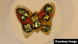 Evelyn Gregory, 11, created this butterfly paperweight under the guidance of fused glass artist Lynda Slayen. (Photo by Gary Slayen)