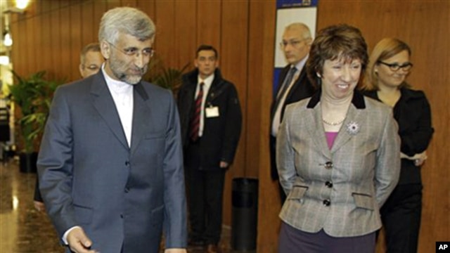 EU foreign policy chief Catherine Ashton, right, greets Saeed Jalili, Iran's chief negotiator in the foyer of the conference center near the Swiss mission to the United Nations in Geneva, 06 Dec. 2010