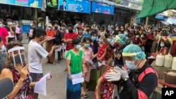 People stand in lines to get COVID-19 tests in Samut Sakhon, South of Bangkok, Thailand, Sunday, Dec. 20, 2020. Thailand reported more than 500 new coronavirus cases on Saturday, the highest daily tally in a country that had largely brought the pandemic u