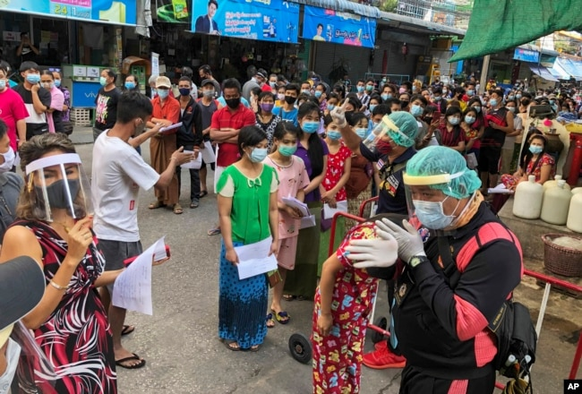 People stand in lines to get COVID-19 tests in Samut Sakhon, South of Bangkok, Thailand, Sunday, Dec. 20, 2020. (AP Photo)