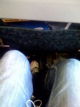 My, but this row offers a lot of legroom. Plenty of room next to you if you get the middle seat, too, no doubt.