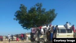 Some touts hanging on kombi windows in Chitungwiza on Tuesday following clashes between the police and kombi drivers. (Photo: Councillor Mutingwende)
