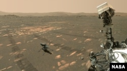 NASA's Perseverance Mars rover took a 'selfie' with the Ingenuity helicopter, seen here about 13 feet (3.9 meters) from the rover. This image was taken by the WASTON camera on the rover's robotic arm on April 6, 2021, the 46th Martian day.