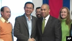 (second from the left) Dr. Kong Sengly the chairman of the volunteer committee and Gov.of Massachusetts Deval Patrick.