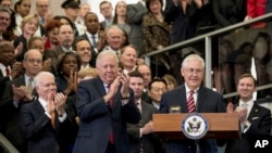 Secretary of State Rex Tillerson, center right, accompanied by State Department Undersecretary for Political Affairs Tom Shannon, center left, pauses while speaking to State Department employees upon arrival at the State Department in Washington, Feb. 2,
