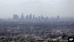Los Angeles is often covered in thick haze. Scientists are studying this and other cities to understand the effects of climate change policies. File photo from 2009.