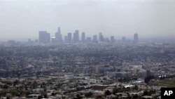 FILE - Smog from smokestacks, diesel engines, automobiles, and other sources of pollution, Los Angeles, April 2009.