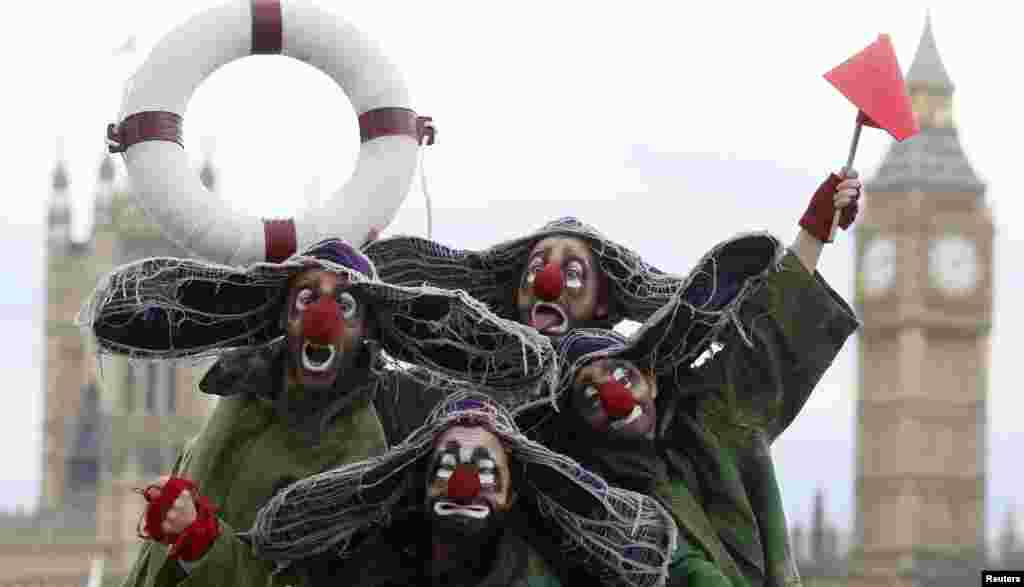 Clowns from Slava's Snowshow pose for photographers on London's South Bank.