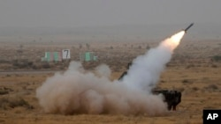FILE - A surface-to-air missile is launched during exercise 'Iron Fist' at Pokhran, India, March 18, 2016.
