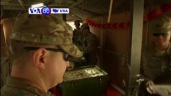 VOA60 America - U.S. troops in Iraq celebrate Thanksgiving
