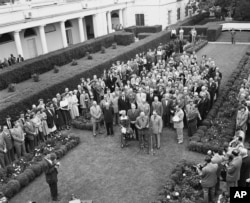 President Harry S. Truman, front center, at White House Rose Garden ceremony, May 17, 1949. Throughout the 20th Century, the Rose Garden has been the setting of news conferences, ceremonies, even state dinners and weddings.