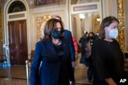 Vice President Kamala Harris arrives to break the tie on a procedural vote as the Senate works on the Democrats' $1.9 trillion COVID relief package, on Capitol Hill in Washington, March 4, 2021.