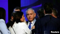 Israeli Prime Minister Benjamin Netanyahu looks on after speaking to supporters at his Likud party headquarters following the announcement of exit polls during Israel's parliamentary election in Tel Aviv, Sept. 18, 2019.