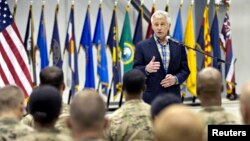 U.S. Defense Secretary Chuck Hagel speaks to members of the military during his visit to Bagram Airfield in Bagram, June 1, 2014.