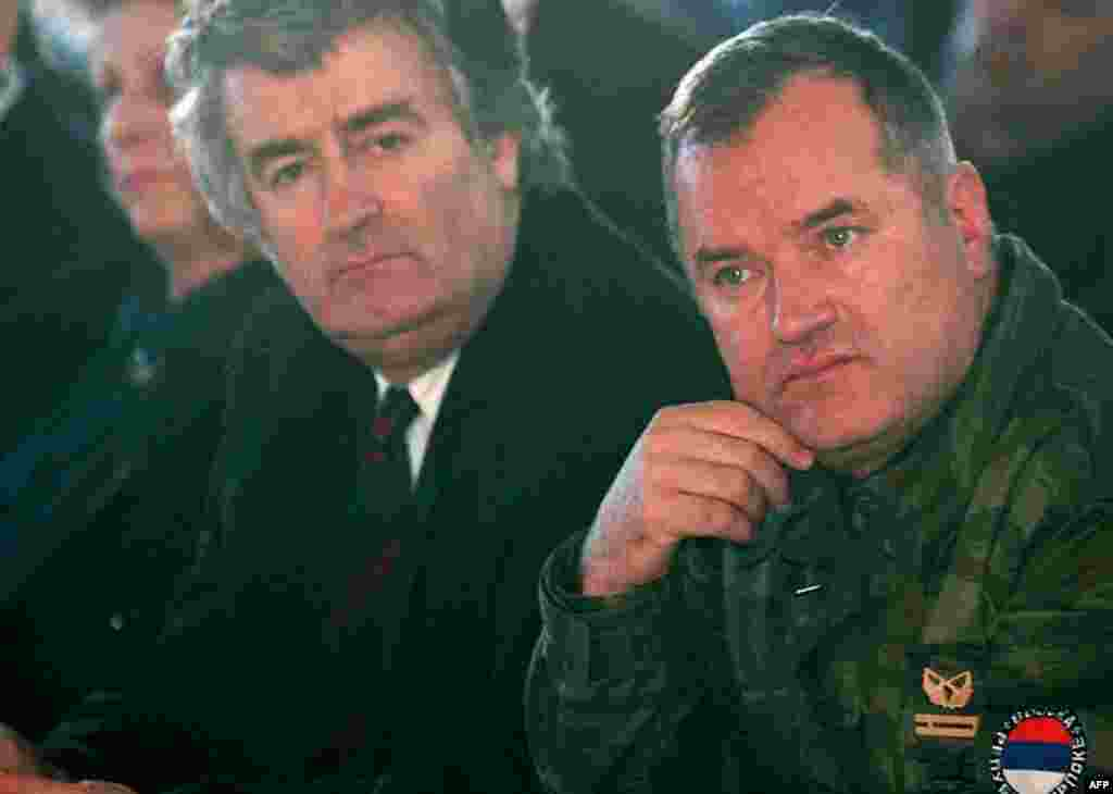Undated file photo showing top war crimes fugitives Bosnian Serb wartime military commander Ratko Mladic, right, and political leader Radovan Karadzic. (AP Photo)