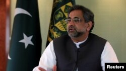 FILE - Pakistan's Prime Minister Shahid Khaqan Abbasi speaks with a Reuters correspondent during an interview at his office in Islamabad, Pakistan, Sept. 11, 2017.