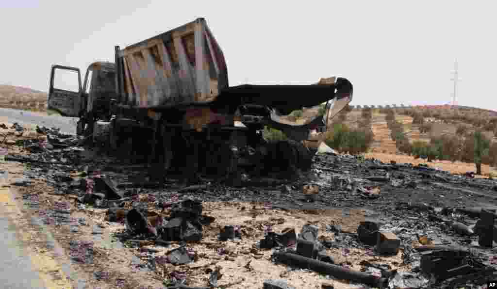 The burnt-out remains of a truck loaded with rockets. Near Tarhouna, Libya. September 4, 2011. VOA - E. Arrott