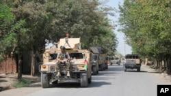 Əfqanıstan təhlükəsizlik qüvvələri Taliban militantlarına qarşı döyüşlərin getdiyi Kunduz şəhərində, 31 avqust, 2019. .