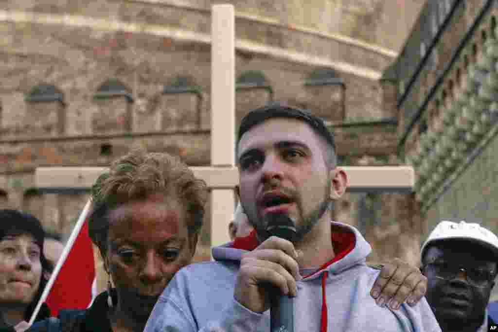 Sex abuse victim Alessandro Battaglia, right, is hugged by victim and founding member of the ECA (Ending Clergy Abuse), Denise Buchanan, as he speaks during a prayer event near Castle Sant' Angelo, in Rome, Italy.