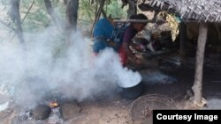 Smoke rises from a cookstove in India, August 2014. (Global Alliance for Clean Cookstoves photo by Radha Muthiah)