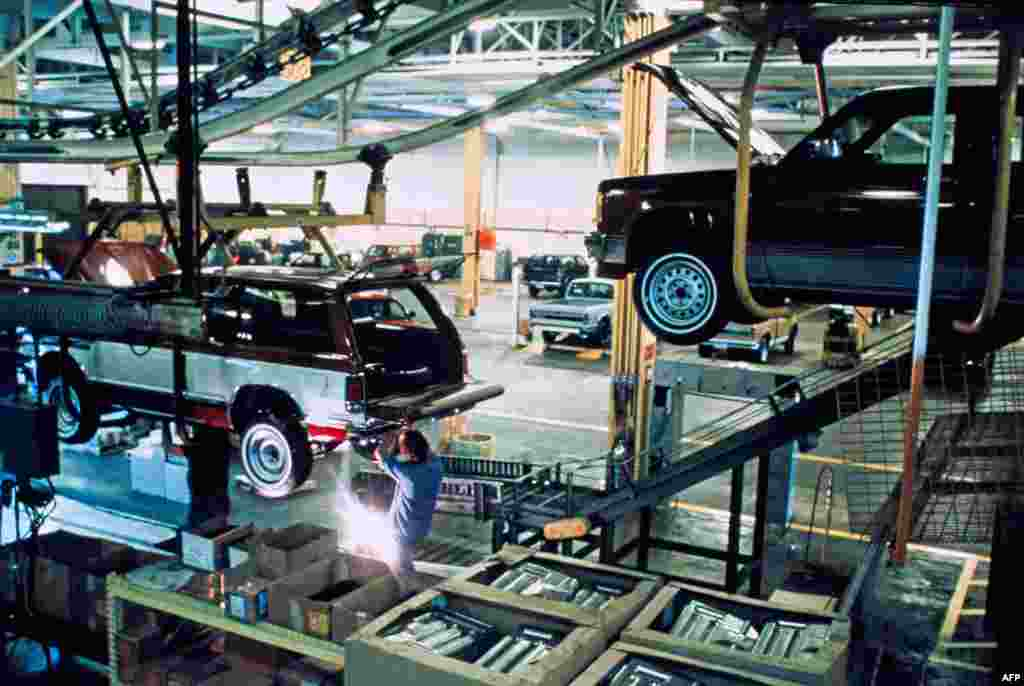 June, 1983: An employee works on the assembly line at the Cadillac carmaker plant in Detroit.
