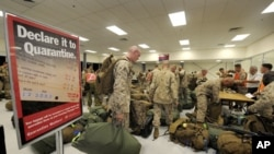 United States Marines of Fox Company, 2nd Battalion, 3rd Marine Regiment complete quarantine checks as they arrive at a Royal Australian Air Force Base in Darwin, April 4, 2012.
