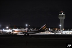 Carrying some 240 American diplomats and citizens, a Boeing 747 aircraft sits on the tarmac in Anchorage, Jan. 28, 2020. Chartered by the U.S. government, the plane flew from Wuhan, China, the source of the coronavirus outbreak.