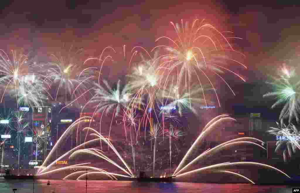 Fireworks explode over Victoria Harbor in Hong Kong to celebrate the Year of the Horse.