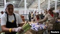 Упаковочный центр программы Местных комитетов по снабжению и производству, с помощью которой режим Мадуро раздает продукты питания жителям Венесуэлы, 28 мая 2019 года